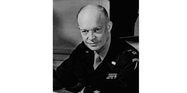 General Dwight D. Eisenhower. Supreme allied Commander, seated at his desk at his headquarters in the European Theater of Operations, February 1, 1945. He wears the Five-Star Cluster and Great Seal of the United States, insignia of the new rank of General of the Army.