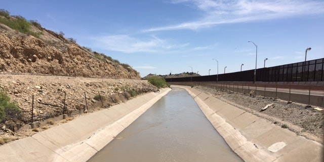 The Rio Grande is channeled through an artificial canal in El Paso. It looks calm on the surface but is too deep to walk through and very swift.