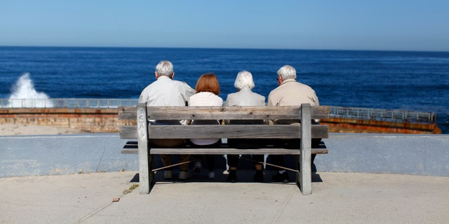 A pair of elderly couples view the ocean and waves along the beach in La Jolla, California March 8, 2012.  (REUTERS/Mike Blake)