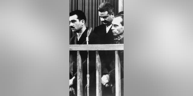 File photo - this picture dated 9 May 1965 shows Israeli spy Eli Cohen (L) and two other unidentified co-defendants, during their trial in Damascus