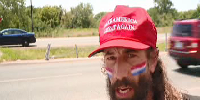 Elliot Timms has been running nearly every day for a year holding an American flag.