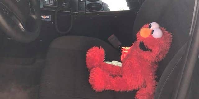 Elmo went out on patrol with the officer before he was placed on a new assignment to watch over the three year old girl.