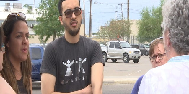 "Gomez wore a shirt reading, ""We are all immigrants,"" while helping the group unload donated items."