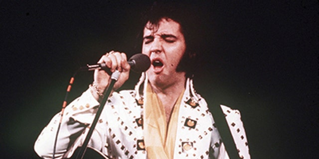 In this 1973 file photo, Elvis Presley sings during a concert. Friends and fans of late singer and actor Elvis Presley are descending on Memphis, Tenn., for Elvis Week, the annual celebration of his life and career. It coincides with the 40th anniversary of the passing of Presley, who died on Aug. 16, 1977. (AP Photo, File)