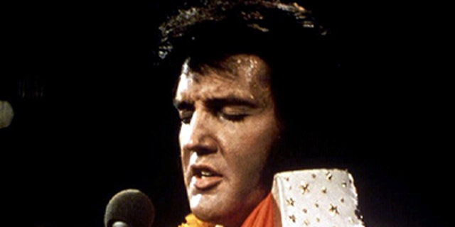 "FILE PHOTO 1972 - Elvis Presley performs in concert during his ""Aloha From Hawaii"" 1972 television special. January 8 marks what would have been Elvis's 60th birthday and fans are expected to gather in his home-town of Memphis for the occasion.  REUTERS/Stringer - RTXGBID"