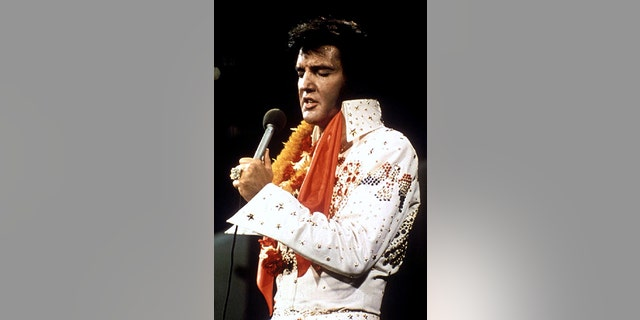 Elvis Presley performs in concert during his 'Aloha From Hawaii' 1972 television special.