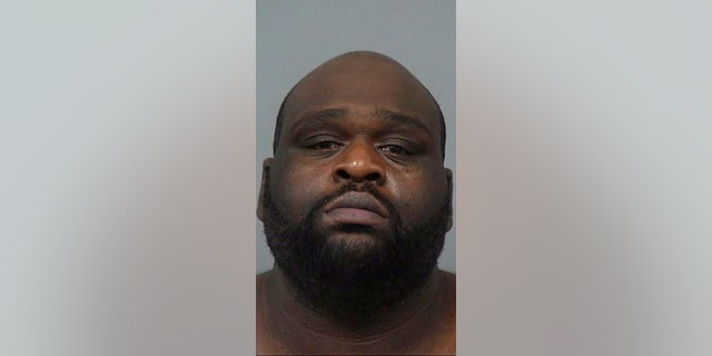 Emanjula Daracus Brown was arrested after allegedly whipping out a gun over a dispute at Burger King.