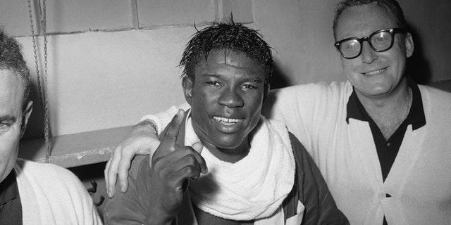 In this June 8, 1963 file photo, Emile Griffith smiles in the dressing room after regaining his welterweight world championship title by defeating Luis Rodriguez, at New York's Madison Square Garden.