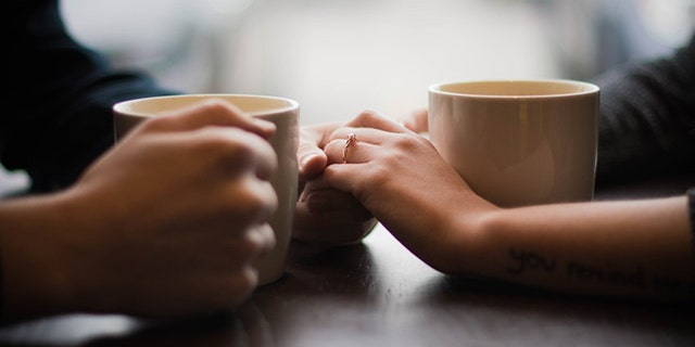 The lovebirds celebrated their photo shoot with a cup of joe.