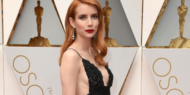 Emma Roberts arrives at the Oscars on Sunday, Feb. 26, 2017, at the Dolby Theatre in Los Angeles.