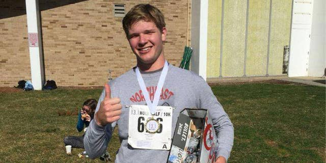 Emmet Farnan, a senior at the University of Notre Dame, finished a Coors Light at every mile marker during a half marathon, as well as one before the race.