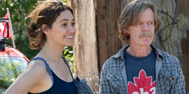 "Emmy Rossum (left) as Fiona Gallagher and William H. Macy as Frank Gallagher in Showtime's ""Shameless."""