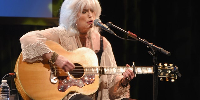 "Emmylou Harris praised fellow singer Vince Gill for singing his song ""Forever Changed."""