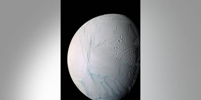 """Observations by NASA's Cassini probe have revealed """"tiger stripe"""" features near the south pole of the Saturn moon Enceladus. Water vapor and other materials from the moon's subsurface ocean jet into space from these fractures."""