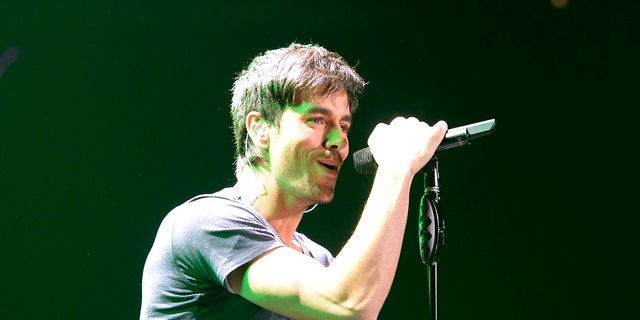 December 6, 2013. Enrique Iglesias performs during KIIS FM's Jingle Ball concert at the Staples Center in Los Angeles, California.