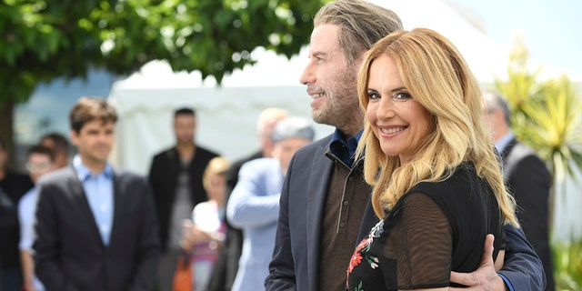 Actors John Travolta and Kelly Preston pose for photographers during a photo call for the film 'Gotti' at the 71st international film festival, Cannes, southern France.