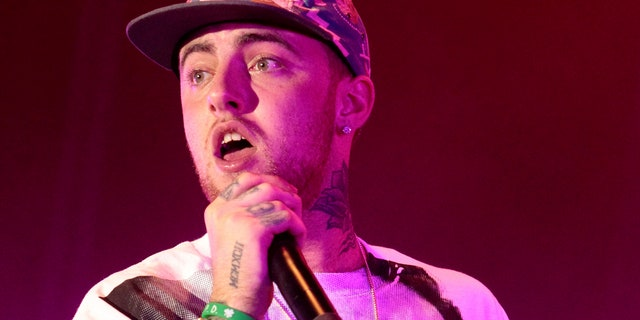 In this July 13, 2013 file photo, rapper Mac Miller performs on his Space Migration Tour at Festival Pier in Philadelphia.