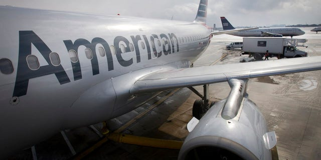 An Illinois dentist says he was booted from a regional American Airlines flight for being overweight.