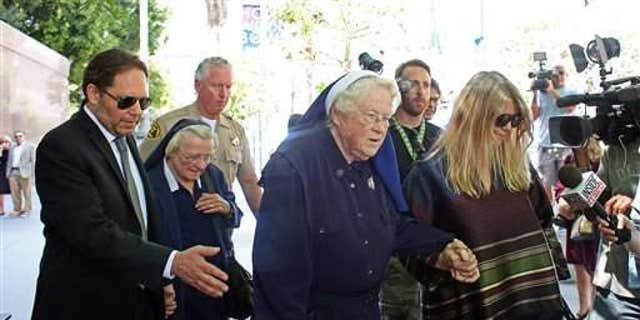 Sister Catherine Rose Holzman, second from left, among a group leaving Los Angeles Superior Court in July 2015. The nuns have been battling with Katy Perry.
