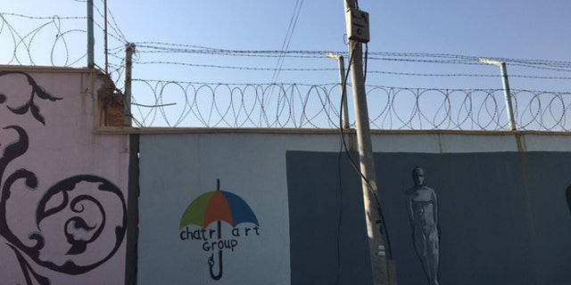 The graffiti-speckled cement exterior walls of the Women and Children's Prison of Erbil. (Photo: Hollie McKay/FoxNews.com)