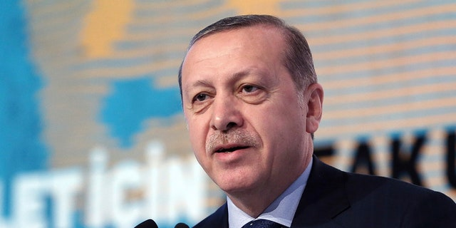 """Turkey's President Recep Tayyip Erdogan addresses a meeting about """"Women and Justice"""" in Istanbul, Friday, Nov. 25, 2016. Erdogan on Friday accused the European Union of dishonesty and betrayal, and threatened to remove controls from his country's borders, flooding Europe with hundreds of thousands of asylum-seekers and other migrants. (Murat Cetinmuhurdar/Presidential Press Service, Pool photo via AP)"""
