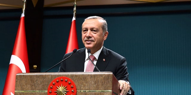 Erdogan is shown speaking after an emergency meeting of the government in Ankara last month.