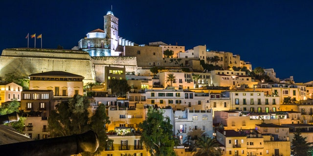 Old town Ibiza on the hill. Houses, fortress and cathedral night scene. Eivissa island, Spain.