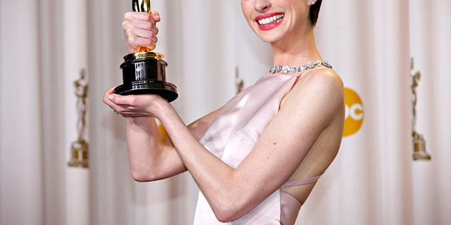 "Anne Hathaway holds her Oscar for winning Best Supporting Actress for her role in ""Les Miserables""
