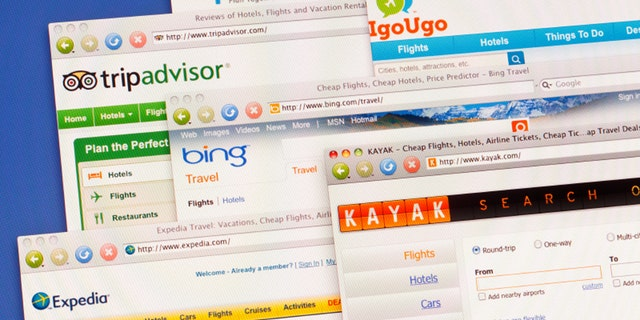 Travel web sites on computer screen including Expedia, Tripadvisor, Bing Travel, Kayak, Triporama and igougo.Shot on a color LCD monitor