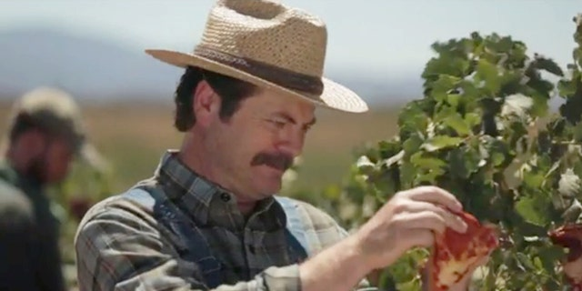 Nick Offerman tends to his juicy, vine-ripened pizza.
