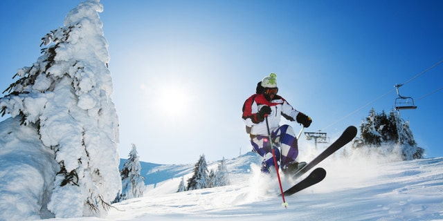 Young skier enjoying while skiing in the mountains. [url=http://www.istockphoto.com/search/lightbox/9786766][img]http://dl.dropbox.com/u/40117171/sport.jpg[/img][/url]