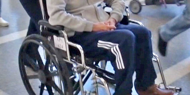 Eric Clapton is seen in a wheelchair at LAX.