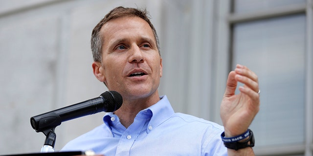 """In this May 23, 2017, file photo, Missouri Gov. Eric Greitens speaks to supporters during a rally outside the state Capitol in Jefferson City, Mo. Greitens told Fox News """"I'm the MAGA candidate in this race,"""" during an interview about his 2022 Senate campaign. (AP Photo/Jeff Roberson, File)"""