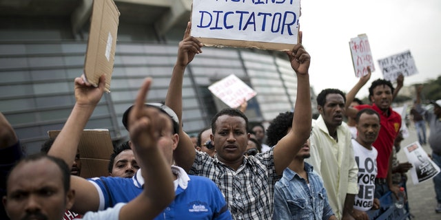 Eritrean refugees hold placards during a protest against the Eritrean government outside their embassy in Tel Aviv in 2015.