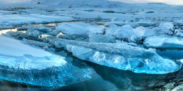 Panoramic view of icebergs in Jokulsarlon glacial lagoon and Breidamerkurjokull glacier on a sunny winter's afternoon in Iceland (HDR)