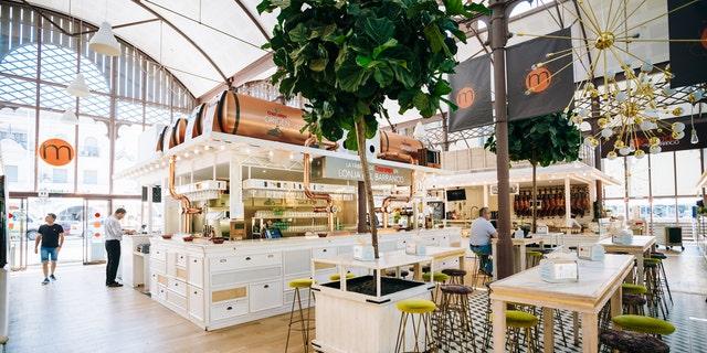 Seville, Spain - June 24, 2015: Food market and a Spanish restaurant Mercado Gourmet Lonja Del Barranco