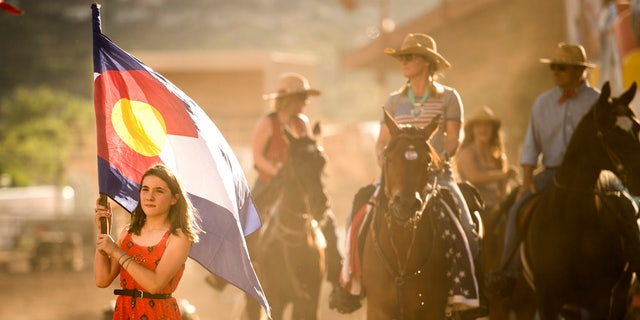 Maebellene Burge carried the Colorado flag during the grand entry for the fourth COS Rodeo of the summer Wednesday, July 6, 2016 at the Norris-Penrose Event Center. The event resumes for four consecutive Wednesday nights at 5pm beginning July 27th. Tickets art $34 and include dinner, rodeo and a concert. Visitors can even participate in certain selected events. Photo by Mark Reis, The Gazette