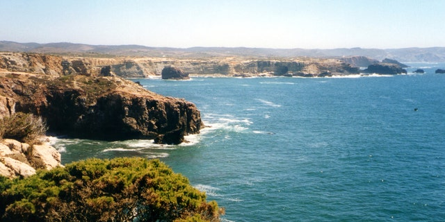 The portugal coastline at the  Parque Natural do Sudoeste Alentejano e Costa Vicentina, near Cabo de São Vicente, a headland in the municipality of Sagres, Algarve, southern Portugal. This cape is the southwesternmost point in Portugal The cliffs rise nearly vertically from the Atlantic to a height of 75 meters.