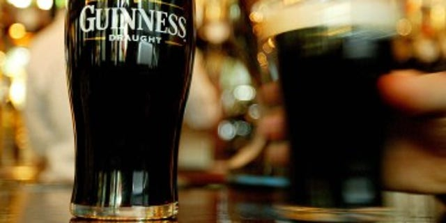 "Pints of Guinness are seen in a London pub, March 1, 2004. The secret ""essence of Guinness"" has been the subject of more intense speculation than of any other beer in the history of brewing. The company publicly acknowledges that barley, water, hops and yeast are all used in the process of concocting Ireland's distinctive black creamy stout. REUTERS/Peter Macdiarmid TO ACCOMPANY FEATURE BC-IRELAND-GUINNESS  PKM/MD/CRB"