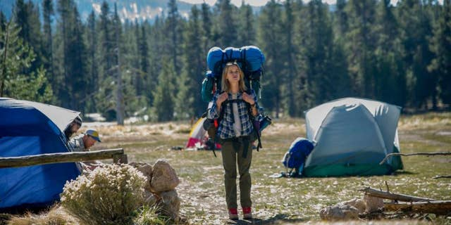 """This image released by Fox Searchlight Pictures shows Reese Witherspoon in a scene from the film, """"Wild."""" The movie """"Wild,"""" which is based on the book by author, Cheryl Strayed, has received Oscar nominations for best actress for Witherspoon and best supporting actress, for Laura Dern."""
