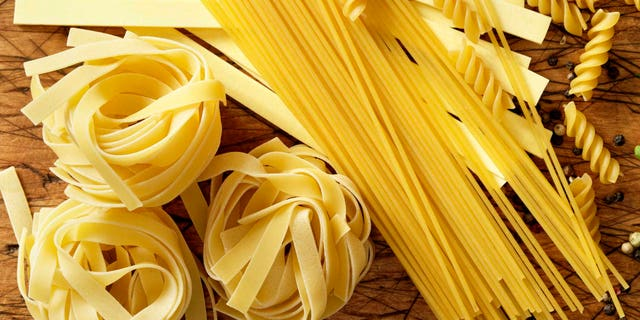 Assorted Pastas on a Cutting Board: Spaghetti, Fettucini, Rotini, Penne and Pappardelle-Photographed on Hasselblad H3D2-39mb Camera