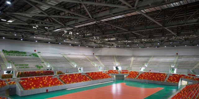 In this April 2016 file photo, workers clean the Future Arena, a temporary venue for Olympic handball this summer.