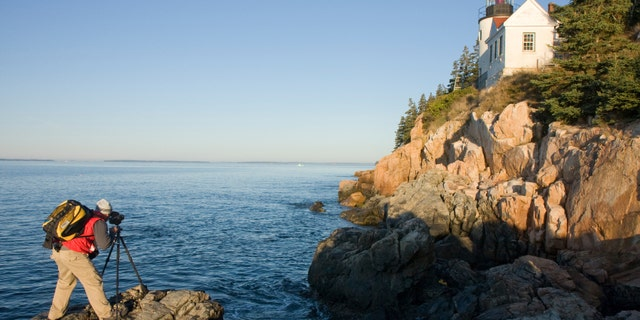 This photographer shoots the Bass Harbor Head Light in Maine with a medium format film camera.