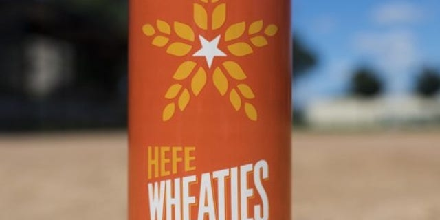 The can of HefeWheaties was inspired by the signature orange cereal box.