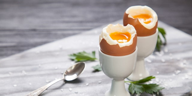 Fresh boiled eggs on marble background