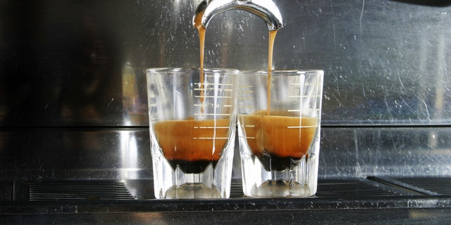 Espresso being drawn out of a professional espresso machine