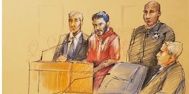 Santiago, second from left, in court.