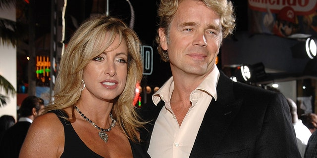 "Actor John Schneider (right) and wife Elly Castle arrives to the premiere of ""Elizabeth: The Golden Age"" at Universal City Walk on October 1, 2007 in Universal City, California."