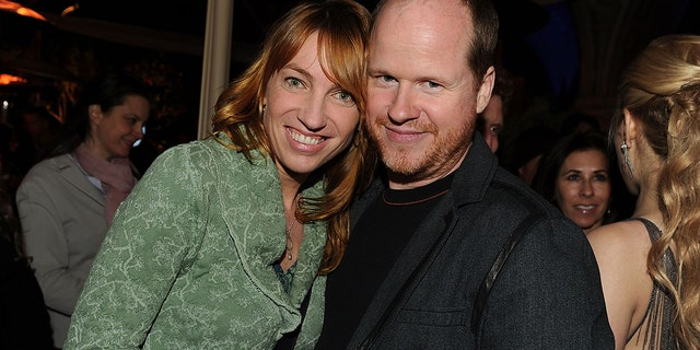 Kai Cole poses with then husband, Whedon, before accusing him of carrying on many affairs during their marriage.