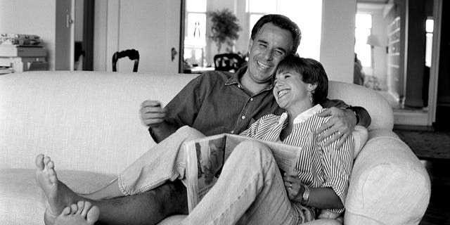 """NBC's the """"Today"""" show co-host Katie Couric at home with her husband, MSNBC legal analyst Jay Monahan. (Photo by Deborah Feingold/Corbis via Getty Images)"""